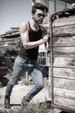 Handsome man model dressed punk, hipster posing dramatic in grun Royalty Free Stock Images