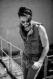 Handsome man model dressed punk, hipster posing dramatic in grun Stock Photo