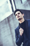 Handsome man, model of fashion, wearing modern suit. Royalty Free Stock Images