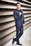 Handsome man, model of fashion, wearing modern suit. Royalty Free Stock Image