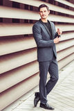 Handsome man, model of fashion, wearing modern suit. Stock Image