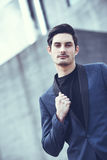 Handsome man, model of fashion, wearing modern suit. Stock Photography