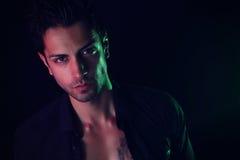 Handsome man model wearing a black shirt Stock Images