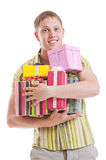 Handsome man with motley gift boxes. Portrait of handsome man with motley gift boxes Royalty Free Stock Image