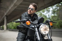 Handsome man on the motorbike Royalty Free Stock Photo
