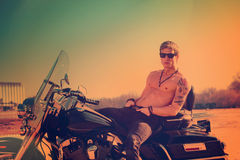 Handsome  man on a motorcycle Royalty Free Stock Photos