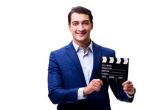 The handsome man with movie clapper isolated on white Stock Photos