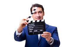 The handsome man with movie clapper isolated on white Royalty Free Stock Image