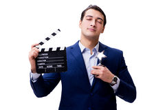 The handsome man with movie clapper isolated on white Royalty Free Stock Photo