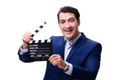 The handsome man with movie clapper isolated on white Royalty Free Stock Photography