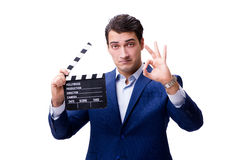 The handsome man with movie clapper isolated on white Royalty Free Stock Images
