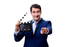 The handsome man with movie clapper isolated on white Stock Image