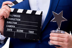 The handsome man with movie clapper  on white Royalty Free Stock Photos