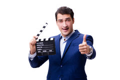The handsome man with movie clapper  on white Stock Image
