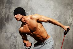Handsome man with muscular body. Doing fitness exercise Stock Photos