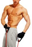 Handsome man with muscular body. Doing fitness exercise Stock Images