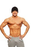 Handsome man with muscular body. Handsome man with muscular torso in beanie hat posing Stock Images