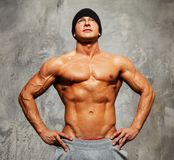 Handsome man with muscular body. Handsome man with muscular torso in beanie hat posing Royalty Free Stock Photo