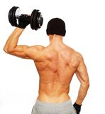 Handsome man with muscular body. Handsome young muscular man exercising with dumbbells Stock Image