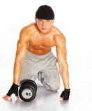 Handsome man with muscular body. Handsome young muscular man exercising with dumbbells Stock Photography