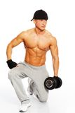 Handsome man with muscular body. Handsome young muscular man exercising with dumbbells Stock Photos