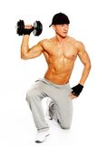 Handsome man with muscular body. Handsome young muscular man exercising with dumbbells Royalty Free Stock Photo