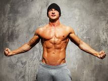 Handsome man with muscular torso Stock Image