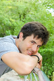 Handsome man in nature smiling Stock Images