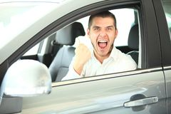 Handsome man in new car Royalty Free Stock Images