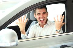 Handsome man in new car Stock Images