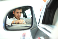 Handsome man in new car Stock Photo