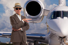 Handsome man next to private jet. Wearing a hat Royalty Free Stock Photography