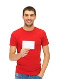 Handsome man with note card Stock Images