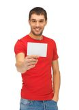 Handsome man with note card Royalty Free Stock Image