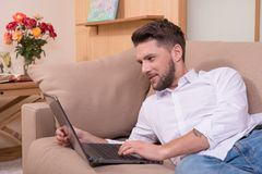 Handsome man with notebook computer Stock Photography