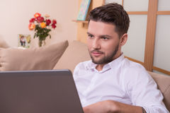 Handsome man with notebook computer Royalty Free Stock Photo