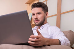 Handsome man with notebook computer Stock Photo