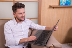 Handsome man with notebook computer Royalty Free Stock Photos