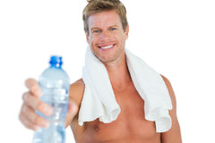 Handsome man offering water Royalty Free Stock Photos