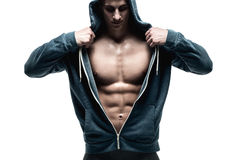 Handsome man with open jacket revealing muscular chest and abs Stock Photos
