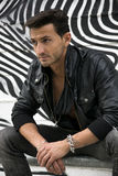 Handsome man outdoor in front of zebra striped graffiti Stock Images