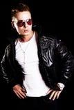 Handsome man over dark background Stock Images