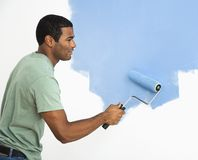 Handsome man painting wall. Royalty Free Stock Photography
