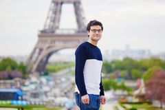 Man in Paris in front of the Eiffel tower Royalty Free Stock Photography