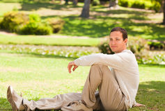Handsome man in the park Royalty Free Stock Images