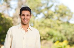 Handsome man in the park Royalty Free Stock Photography
