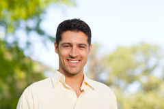 Handsome man in the park Stock Image