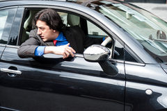 Handsome man parking his new car safely Stock Photography