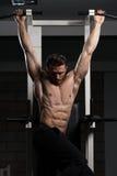 Handsome Man Performing Hanging Leg Raises Exercise Royalty Free Stock Image