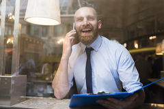 Handsome man on the phone Stock Photography
